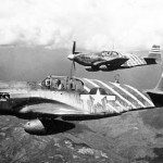 North American P-51A two ship formation of the 1st Air Commandos. Background (#1) plane flown by C.O. Phil Cochran; #13 Miss Virginia flown by Deputy Commander Petty. (U.S. Air Force photo)