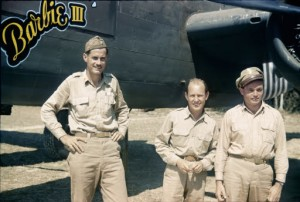 The photograph was taken in front of R.T. Smith's B-25H Barbie III at Hailkandi, India. Bomber Section Commander R.T. Smith; Cocommander John Alison; and Cocommander Phil Cochran.